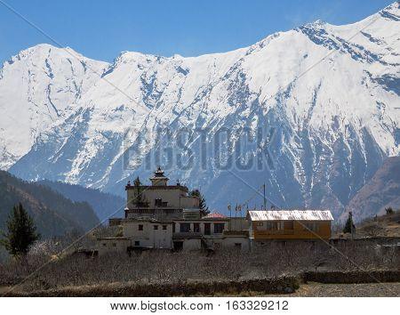Lone Buddhist monastery in Himalayas mountains Nepal