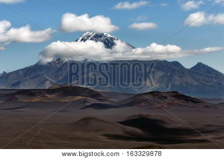 Kamchatka Peninsula Russian Far East: beautiful summer volcanic landscape - view of stratovolcano Bolshaya Udina Volcano in Klyuchevskaya Group of Volcanoes.