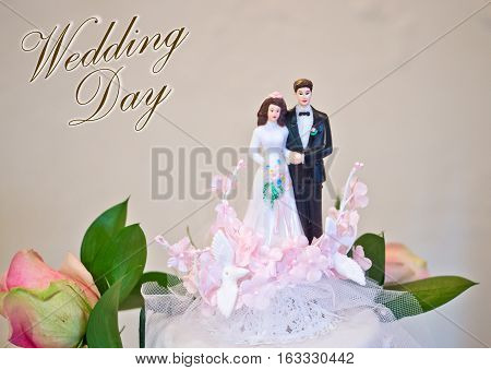 Figurines Of The Bride And Groom Wedding Cake