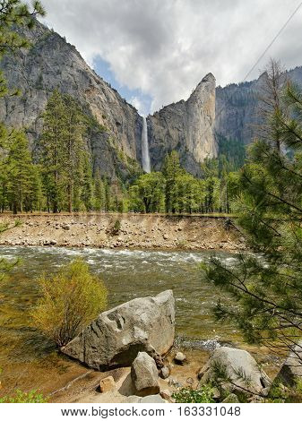 Waterfall in Yosemite and Merced River. Yosemite valley, California