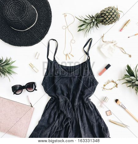 Summer casual style. Modern woman clothes and accessories collage. Dress sunglasses hat purse lipstick and pineapples. Flat lay top view