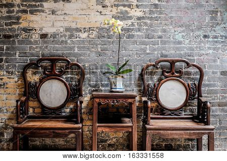 Traditional oriental chinese heritage building wood table chair and decorate with beautiful orchid in Macao/Macau China