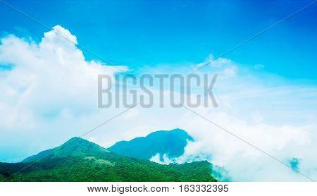 Panoramic bird eye aerial view of beautiful morning sunrise dramatic cloud of sea grassland under bright blue sky in Yangmingshan(Yang ming Mountain) National Park in Taiwan