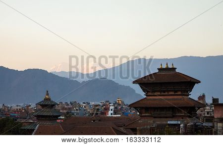 Kathmandu Nepal. Red roofs with Himalaya Mountains on the background at sunset.