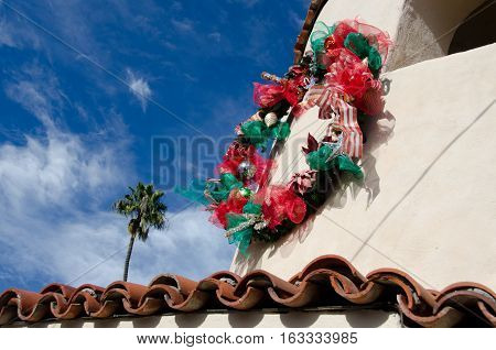 Palms And Christmas Decoration Frame Building In Spanish Village