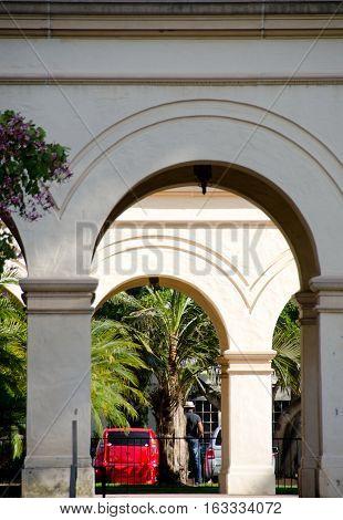 Looking Through Casa El Prado Colonnade At Street Near Museum Of History