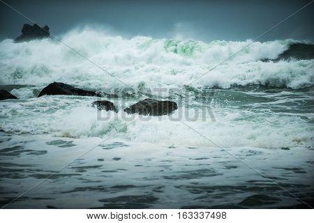Waves Crashing Onto The Rocks