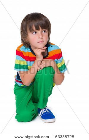 Pensive Young Boy In The Green Pants