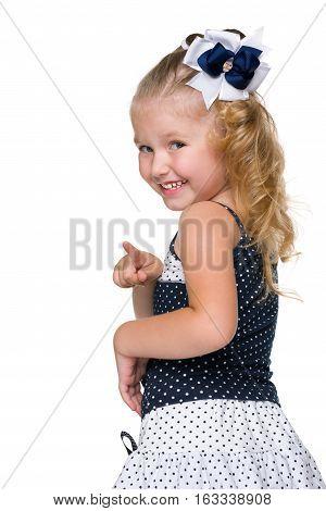 Laughing Little Girl Shows Her Finger Forward