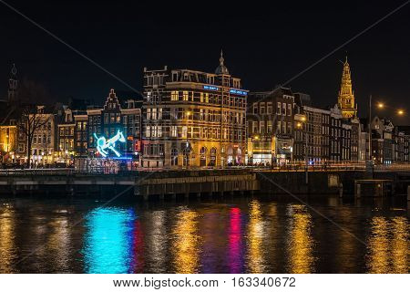 AMSTERDAM, NORTH HOLLAND/THE NETHERLANDS - DECEMBER 3, 2016: Night city view from railway station at Amsterdam Light Festival