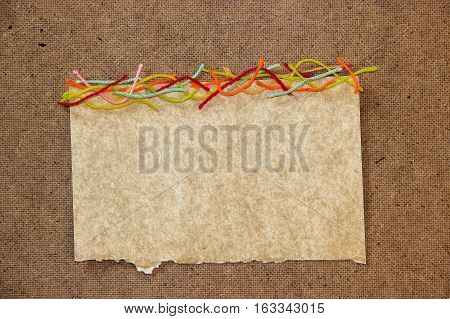 Wool Thread, Piece Of Paper Element  Laid Out On Cardboard