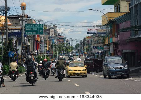 Street view and local life in the city of Pekanbaru, Indonesia, november 2013