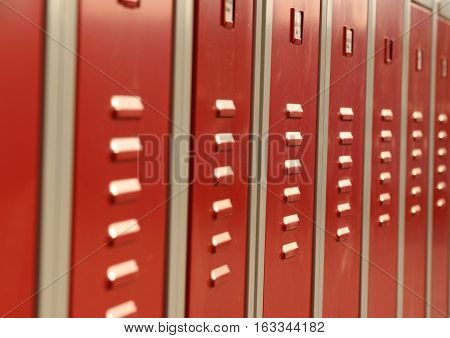 Red colored cabinets to store private belongings on an industrial facility