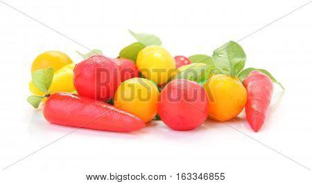 Group of imitation fruits on white floor.