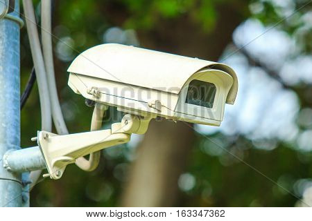 CCTV security camera, Closed circuit television in the public park.