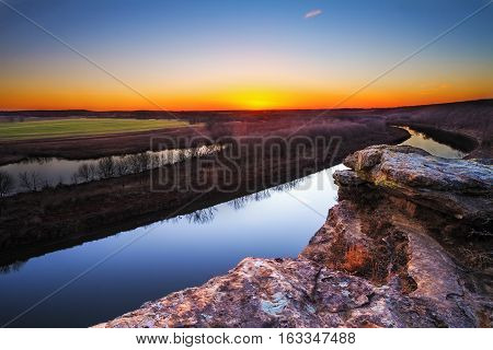 A view from a bluff on Monegaw Springs Missouri overlooking the Osage River at dusk.