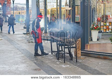 Moscow Russia - December 21 2016: The cook prepares food for visitors of the Festival