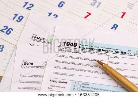 us 1040 tax form with calendar pen