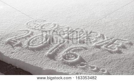 Word goodbye 2016 hand drawn in fresh snow vintage style white grey gradient overlay