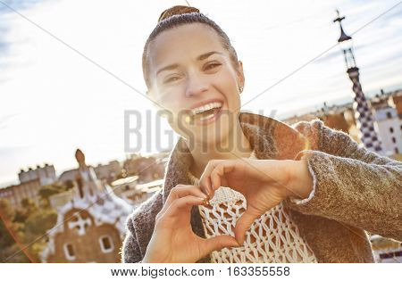 Smiling Woman At Guell Park Showing Heart Shaped Hands