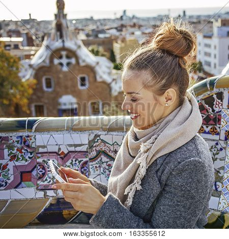 Traveller Woman At Guell Park In Barcelona, Spain Writing Sms