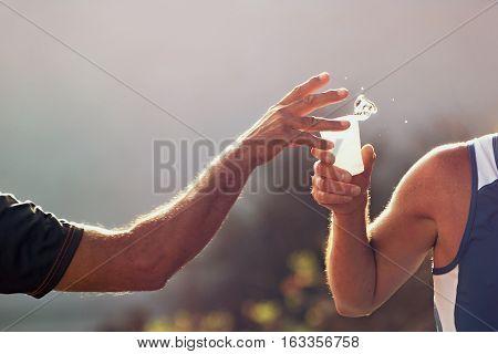 Uložit Náhled stahování Drinks station at a marathon.Runner take a water in a marathon race
