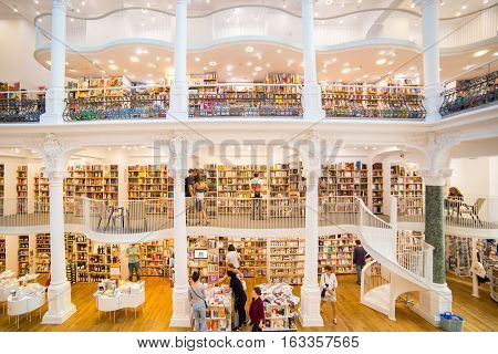 BUCHAREST ROMANIA - SEPTEMBER 3 2016: LITERATURE BOOKS IN CARTURESTI LIBRARY THE MOST BEAUTIFUL LIBRARY IN BUCHAREST