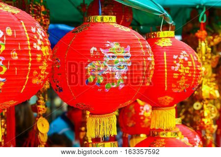 Many Chinese red paper lantern or lamp decoration for Chinese New Year Festival. With greeting word wish you have a good year, good health, good luck and rich.