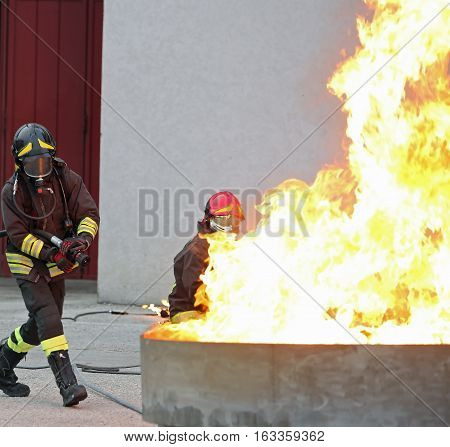 Firefighters During A Training Exercise Off A Huge Fire In The B