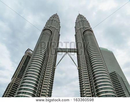 KUALA LUMPUR, MALAYSIA - JANUARY 12, 2014: Petronas Twin Towers. Kuala Lumpur, Malaysia