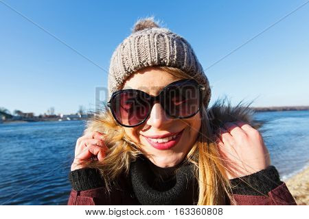 Portrait of a happy tourist by the Danube river in Esztergom Hungary