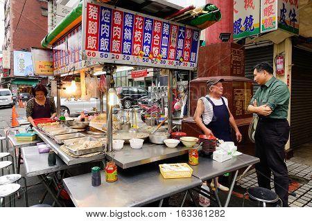 People Selling Foods On Street At Night