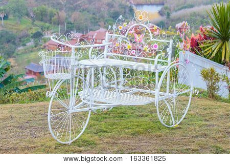 Cute or beautiful Tricycle souvenir on a hill or mountain.