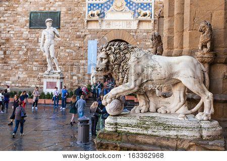 Medici Lion And Entrance Of Palazzo Vecchio