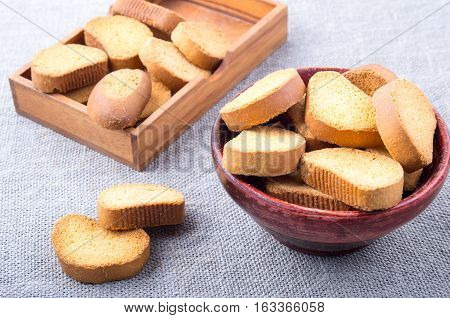 View Close-up On Slices Of Rusk In The Old Brown Wooden Crockery