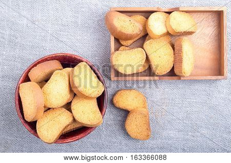 Top View Of The Pieces Of Dried Bread In An Old Brown Wooden Crockery