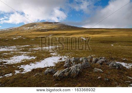 Plateau Lago-Naki in Adygea in the Caucasus in the first snow in the autumn