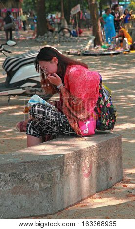 Kochi India - March 7 2015: tourist is exploring a region map outdoor in Kochi India