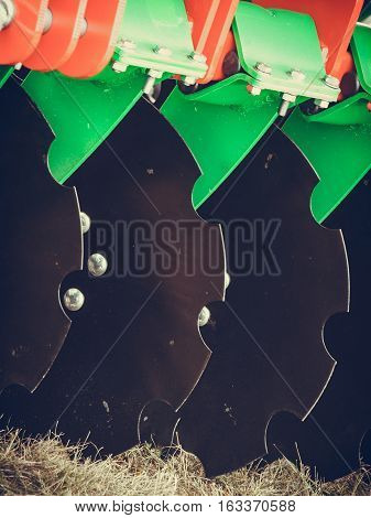 Agriculture equipment concept. Detailed closeup of disc harrow agricultural machinery. Outdoor shot