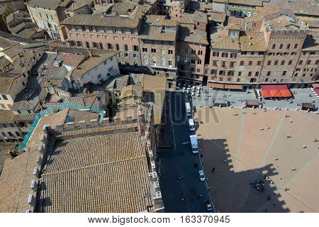 Siena Italy - September 8 2016: Aerial view of Piazza del Campo in medieval Siena city in Tuscany Italy. Unidentified people visible.