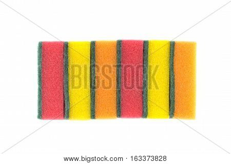 Stack of color kitchen cleaning sponges isolated on white background front view closeup