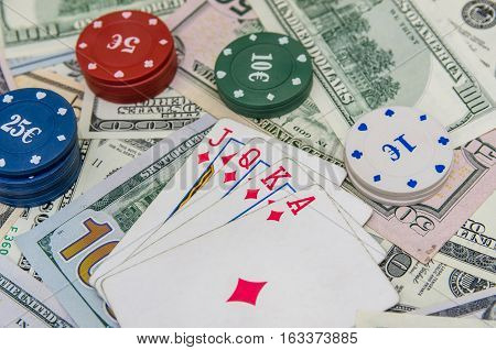combination of poker play cards chips and dollar