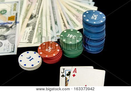 Poker chips play cards and dollars in casino