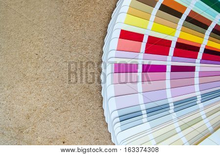 open sample colors catalogue on wood background