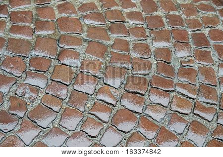 old brown wet cobbles for background or texture