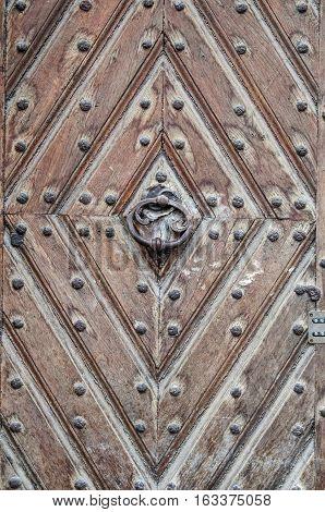 old door background texture with metal rivets