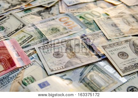 many dollar and euro bills for background
