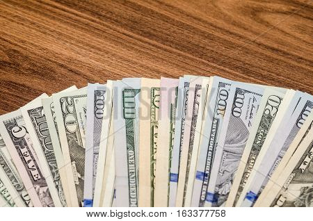 different dollar face value banknotes on table