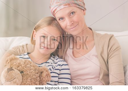 Ill Woman Embracing Child