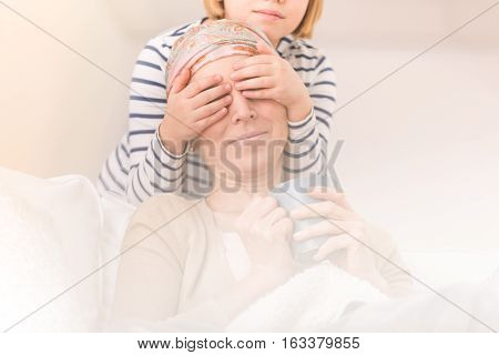 Child Playing With Ill Mother